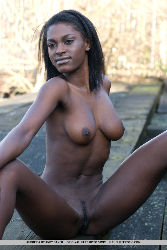 Naked black ebony bent over